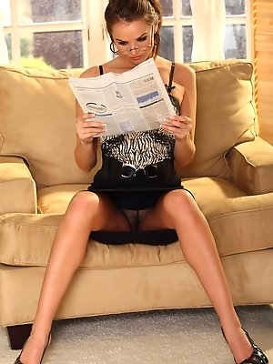 Tori Black reading the newspaper in a little tiny outfit.