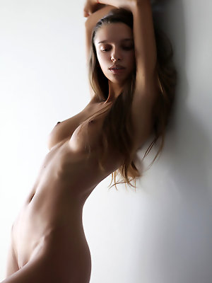 Newcomer Elin displays her sexy, slender body and long legs indoors.