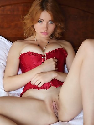 """""""Kika's bright red corset compliments her fair, porcelain smooth skin, highlighting her perfectly round breasts, slim waist, and smooth shav"""